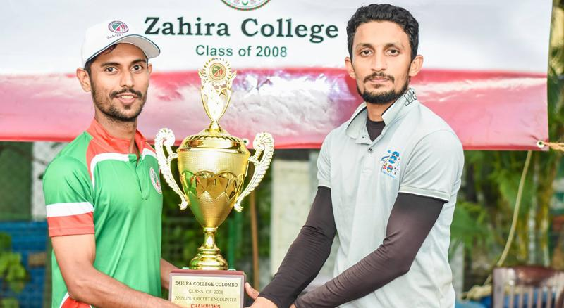 Strange Giants team captain Mohamed Usman receiving the champion award from Class of 2008 president Bilal Miskin