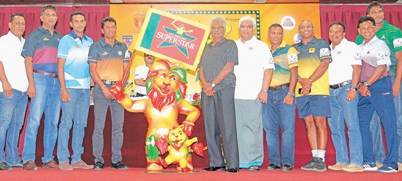 The front-line force! From left- Ravindra Pushpakumara, Pramodya Wickremasinghe, Chamila Gamage, Upul Chandana, Roy Dias, Arjuna Ranatunga, Lanka de Silva, Hashan Tillekaratne, Nalliah Devarajan, Hemantha Devapriya and Nuwan Zoysa with their Lion mascot