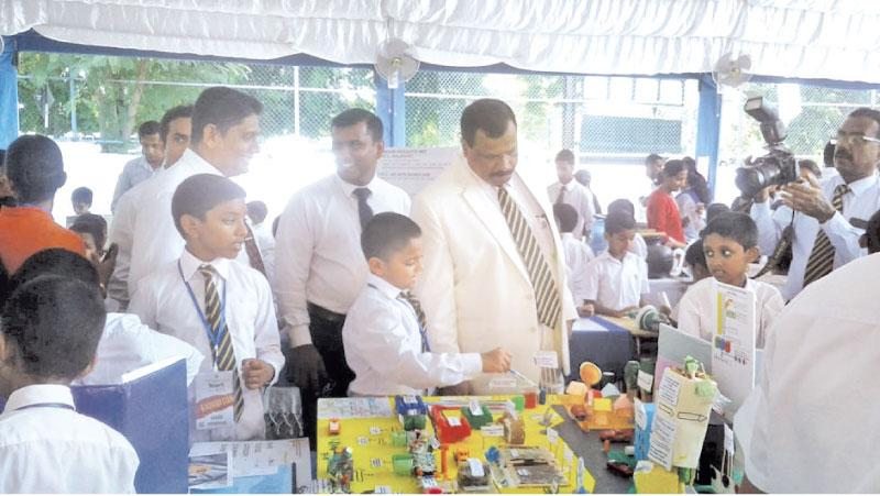 Anish explaining his project to Royal College Principal B.A. Abeyrathna at the Spark '18 exhibition