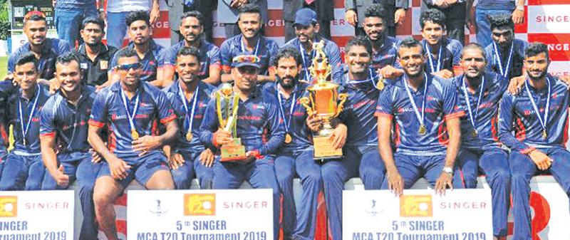 The champion MAS Intimates Unichela team comprising T.M Dilshan (Captain) , T.N,Sampath, Ramith Rambukwella, Priyamal Perera, Fervez Maharoof, Hasitha Boyagoda, Anuk Fernando, Nipun Ransika, Lahiru Jayaratne, Dhanushka Gunatilaka and Dunil Abeyweera celebrate with the trophy