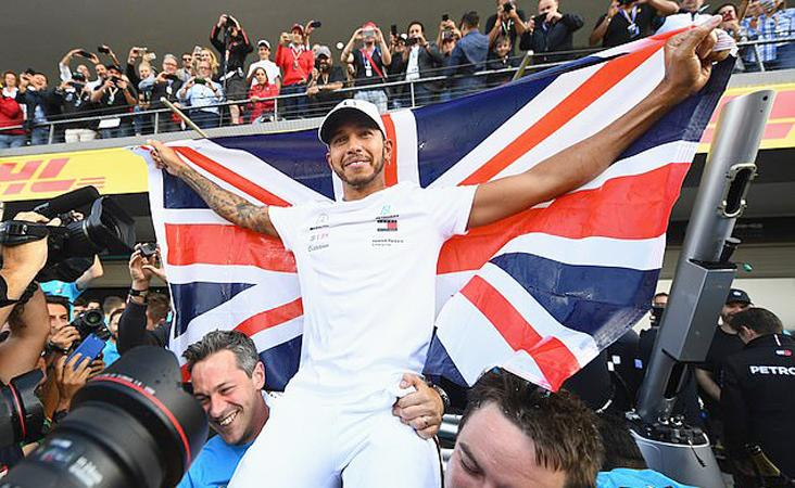 Hamilton drapes himself in a Union Jack flag