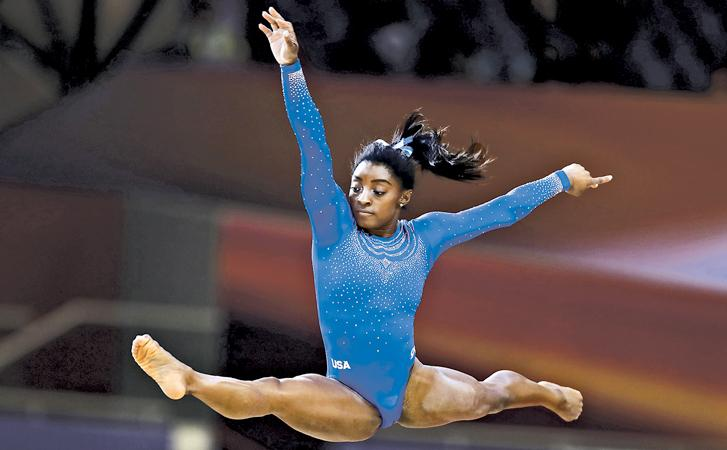 DOHA, QATAR: Simone Biles of the USA competes in the 2018 FIG Artistic Gymnastics Championships at Aspire Dome in Doha, Qatar.  (Photo by Francois Nel/Getty Images)