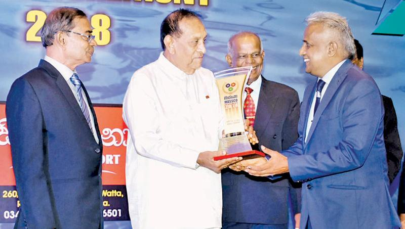 Picture shows Managing Director, M. Selvaraja receiving the MASSCO Award from the Speaker.