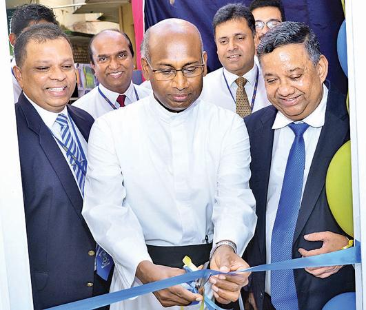 Rector St. Sebastian's College, Rev Fr Ranjith Andradi, Managing Director/CEO of HNB Jonathan Alles and , Board Director, HNB open the new Student Savings Unit.