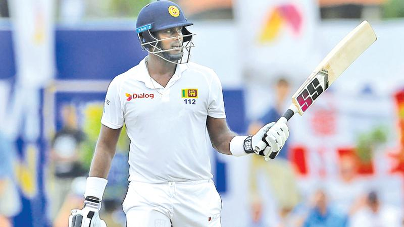 Sri Lanka's Angelo Mathews celebrates his half century (AP Photo by Eranga Jayawardena)
