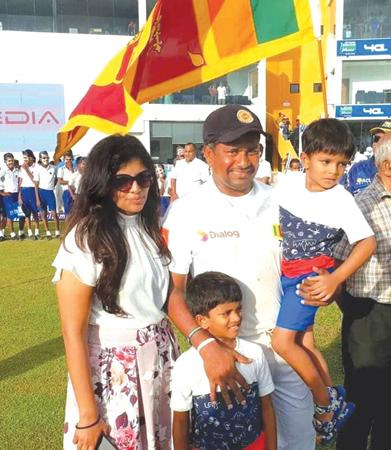 Rangana Herath with his wife Senani and sons at his farewell
