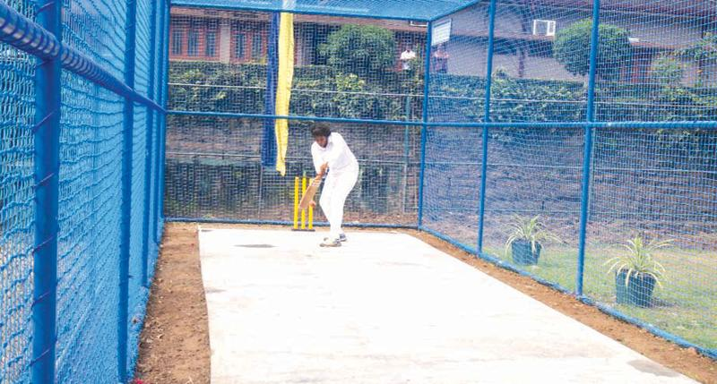 A girl from Mahamaya bats at the new practice pitch