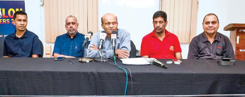 Tournament Director Ajith Wijayasinghe (centre) addressing the media. Also in the picture are, (from left) Clarence Homer (Secretary CMBA), Rohan de Silva (President CMBA), Sanjeeva Wijesekera (Officer in Charge of Umpires) and Trevor Reckerman (Deputy Tournament Director)