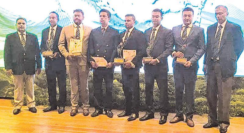 The Talawakelle Tea Estate team at the Presidential Environmental Awards 2018. From left: Senaka Alawattegama, Sarath Ranaweera, Aruna Dissanayake, M. M. K. Bandara, Rakitha Pathiraja, Nalin Kumara, Eranga Egodawela and Dilantha Seneviratne.