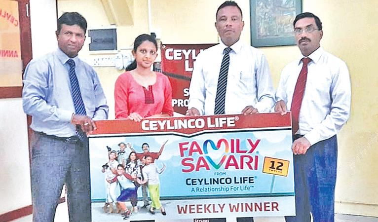 Ceylinco Life Family Savari weekly winner S. Mathushana of Hatton (second from left) receives her prize from Ceylinco Life's Unit Head Ajith Wijeyashantha, Zonal Manager Nazmi Abdeen and Branch Head L. Udayakumar.