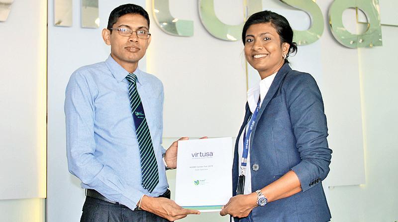 Senior Director, HR at Virtusa, Chandi Dharmaratne (right) and Manager, Career Guidance of NSBM, Kapila Liyanage exchange the partnership documents.