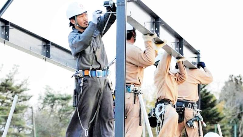 Japan will allow some foreigners to work in construction and other sectors