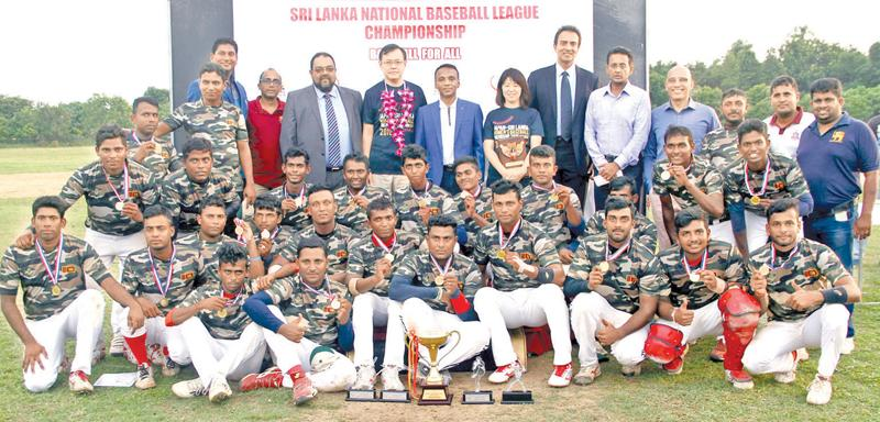 The victorious Army team pose for a picture after receiving the Champions Cup from Chief Guest ambassador Akira Sukiyama. Also in the picture are Madam Sugiyama, President of SLBF Fazil Hussain, CEO Horizon Ajith Wijesuriya and Priyantha Ekanayake (CEO SLBF)  Picture by Sulochana Gamage