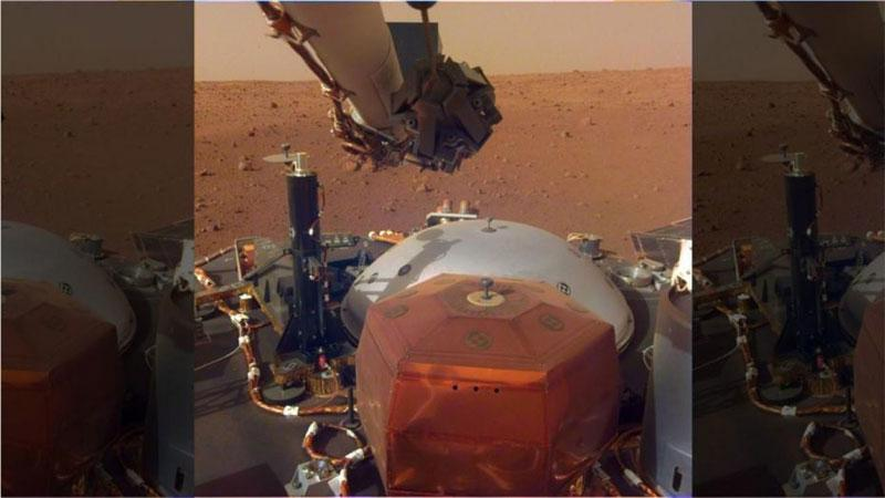 This image from InSight's robotic-arm mounted Instrument Deployment Camera shows the instruments on the spacecraft's deck, with the Martian surface of Elysium Planitia in the background. The image was received on December 4, 2018                                                        Credit: NASA/JPL-Caltech