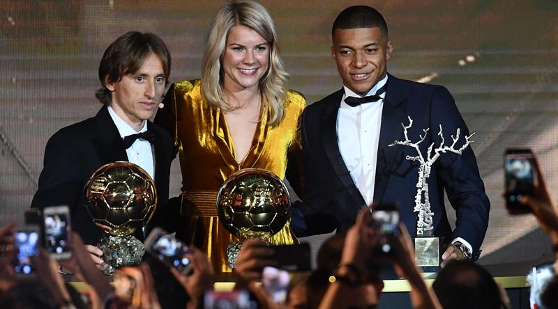 (From L) 2018 FIFA Ballon d'Or awarded for best player of the year, Men's Ballon d'Or Real Madrid's Croatian midfielder Luka Modric, Women's Ballon d'Or Olympique Lyonnais' Norwegian forward Ada Hegerberg and Under-21 Ballon d'Or (Koppa trophy) Paris Saint-Germain's French forward Kylian Mbappe pose at the end of the 2018 FIFABallon d'Or award ceremony at the Grand Palais in Paris  (AFP)