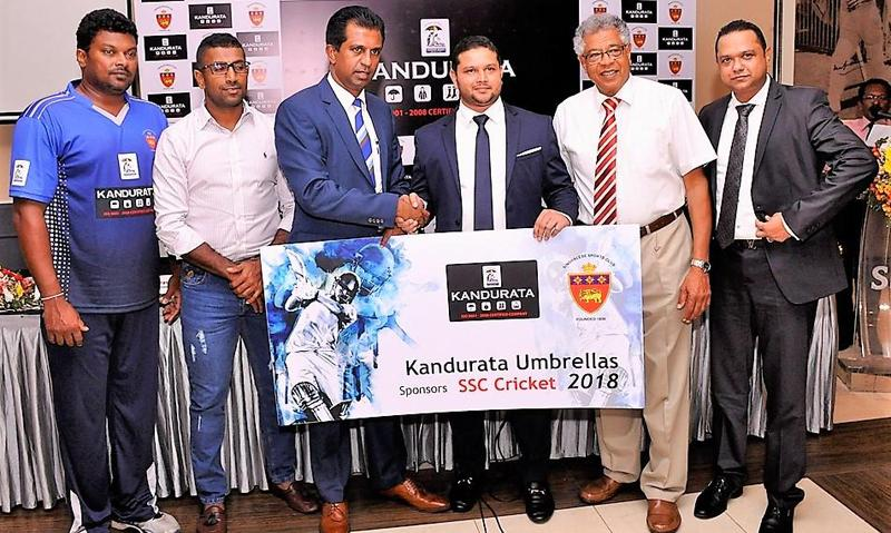 MTM Naufal, Managing Director of Kandurata Umbrella (third from right) handing over the sponsorship cheque to Samantha Dodanwala the chairman Cricket House Committee SSC in the presence of (from left) Thilina Kandambi (head coach SSC), Dammika Prasad (captain SSC), Michael De Zoysa (member Cricket House Committee and Ground Secretary) and MTM Naushad (chairman Kandurata Umbrella)  Picture by Herbert Perera