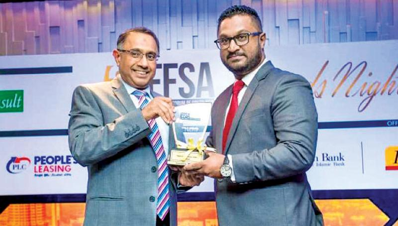Al Safa Islamic finance unit Chief Manager Mohideen Maharoof receives the Bronze award for 'Islamic Finance Product of the Year'.