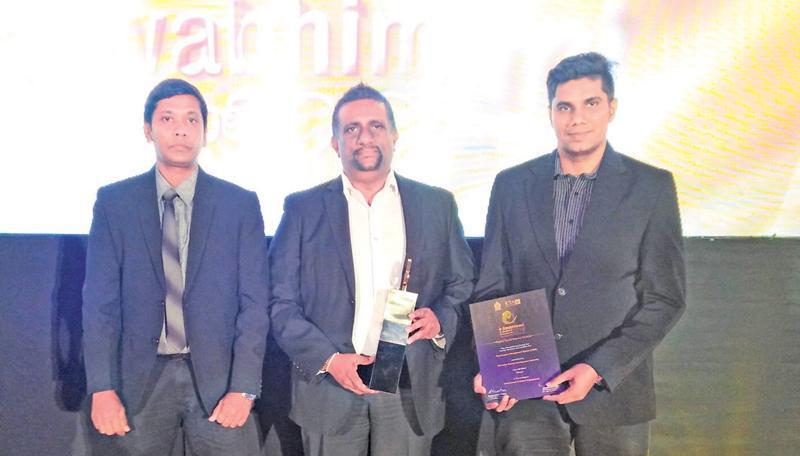 Sri Lanka Tourism officials Udana Wickremasinghe, Director ICT, Hirosh de Silva and Chandana Munasinghe with the award.