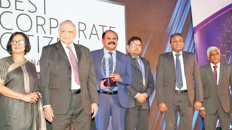 SLT Group Chairman P. G. Kumarasinghe Sirisena with the award