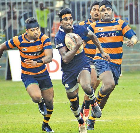 Police player Sachith Silva heads for the try line after beating the Army defence in their Dialog League rugby match yesterday                                                                                                                                                                                                (Picture by Saman Mendis)