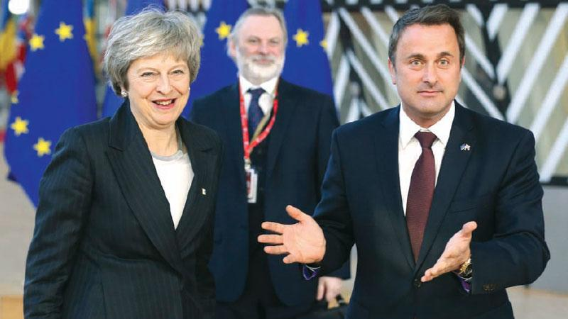 Luxembourg's Prime Minister, Xavier Bettel (R), said EU leaders know what Theresa May (L) wants, 'the problem is the MPs in London'. Pic: Xinhua/Rex/Shutterstock