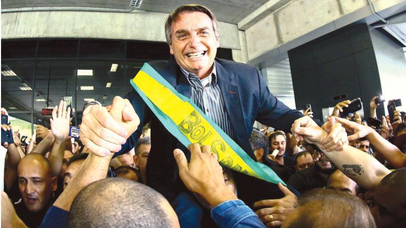 President-elect Jair Bolsonaro, who takes power on 1 January, is famed for his loathing off Venezuela's leader, Nicolás Maduro.   Pic: Heuler Andrey/AFP/Getty Images
