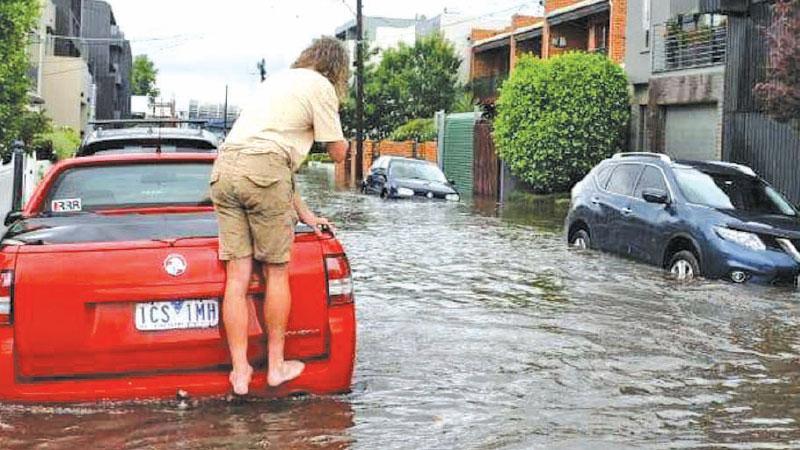 Glass Street in Richmond floods after heavy rains. Pic: News Corp Australia