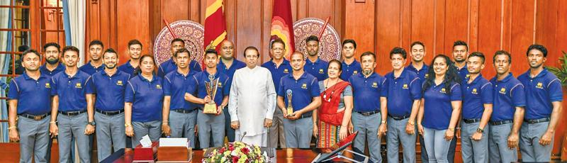 The champion cricketers from the Sri Lanka Deaf Cricketers' Association which won the recent World Cup in India pose for a ceremonial picture with President Maitripala Sirisena. The winning team comprised Gimadu Malkam (Captain), Sumudu Lanka (Vice Captain), Tharaka Sampath Jayasinghe, Lakshan Fernando, Tharindra Deepika Wimalaweera, Goyum Shanaka Walgama (Wicket-keeper), Chamara Dishan, Asanka Manjula, Udaya Lakmal, Rajitha Asanka, Alenross Kalep, Ushan Lakshitha, Nuwan Hasaranga, Dinuka Sachin and Janaka