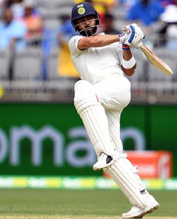 India's batsman Virat Kohli plays a shot (AFP)