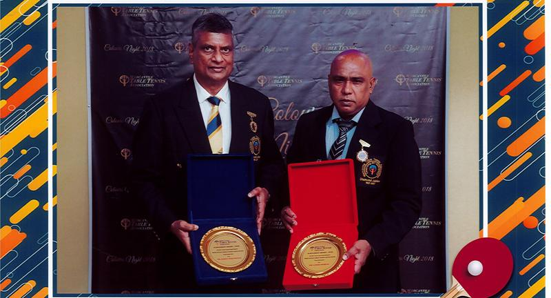 Wijetunge (left) and Moraes posing with their awards