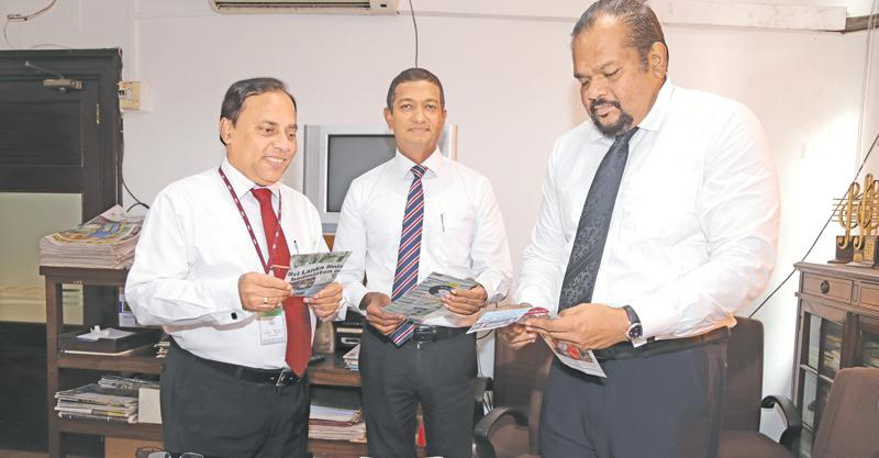 Rasanga Harischandra (right) Director Legal, Samith Kotalawala (C) DGM Corporate planning and Financial Services and Waruna Mallawarachchi (L) going through the entries at the  ANCL office (Pic by Thilak Perera)