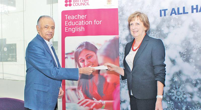 Ricky Mendis presents the final tranche of the payment to British Council Country Director Gill Caldicott.