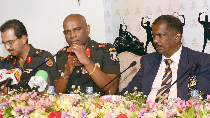 Army commander Lt. General Mahesh Senanayake (centre) speaks to the media on their future plans. Others in the picture are Lt. General Jagath Gunawardena (left) president of Army Sports and Air Commodore (Rtd) Ajith Abeysekera (right) president of Sri Lanka Squash.   Picture by Wimal Karunathilake