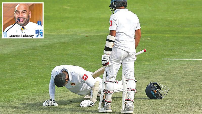 Kusal Mendis watches his former captain Angelo Mathews do dips and push-ups in a strange scenario during the concluded first cricket Test against New Zealand in Wellington