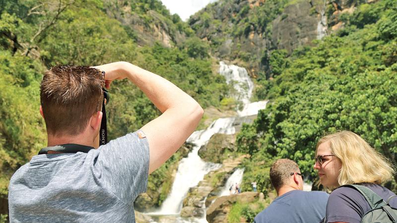 The 'Lonely Planet' Guide Book has nominated Sri Lanka as the top destination for 2019 and a global marketing campaign is due to be launched soon by the Sri Lanka Tourism authorities. Here tourists admire Ravana Falls on the Ella-Wellawaya road. Pic: Thilak Perera