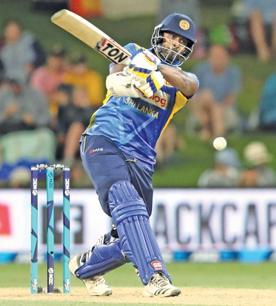 Thisara Perera plays the shot that had him dismissed caught at long-on by Trent Boult for 140 AFP