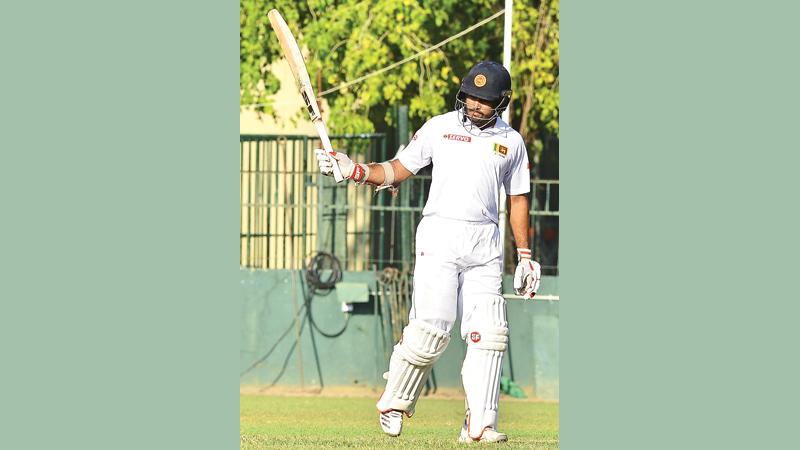 Sri Lanka A batsman Milinda Siriwardena acknowledges his half century against Ireland A at the SSC ground in Colombo yesterday