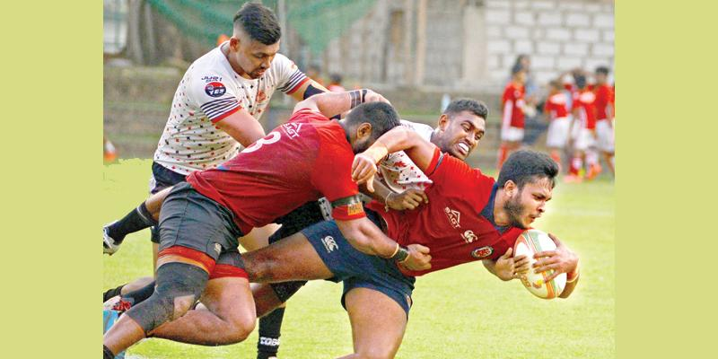 CR's flanker Rehan Silva goes over for a try (Pic by Thilak Perera)