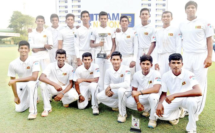 The Sri Lanka Under 19 squad comprising Nipun Perera (captain), Navod Paranavithana, Kamil Mishara, Sonal Dinusha, Mohammed Shamaz, Raveen de Silva, Thaveesha Abishek, Avishka Tharindu, Lakshan Gamage, Chamindu Wijesinghe, Praveen de Silva, Dilshan Madusanka, Ashain Daniel, Rohan Sanjaya and Dilum Sudeera pose with their trophy after beating Australia