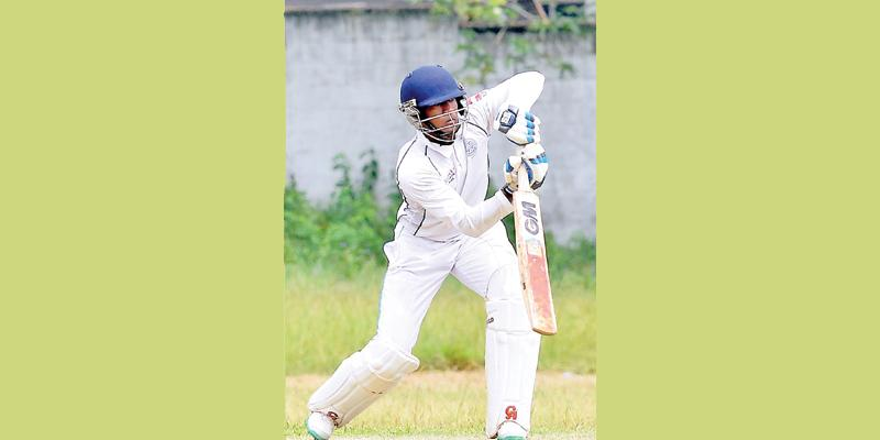 Wesley College batsman Kavindana Perera drives a ball (Picture by Saman Mendia)