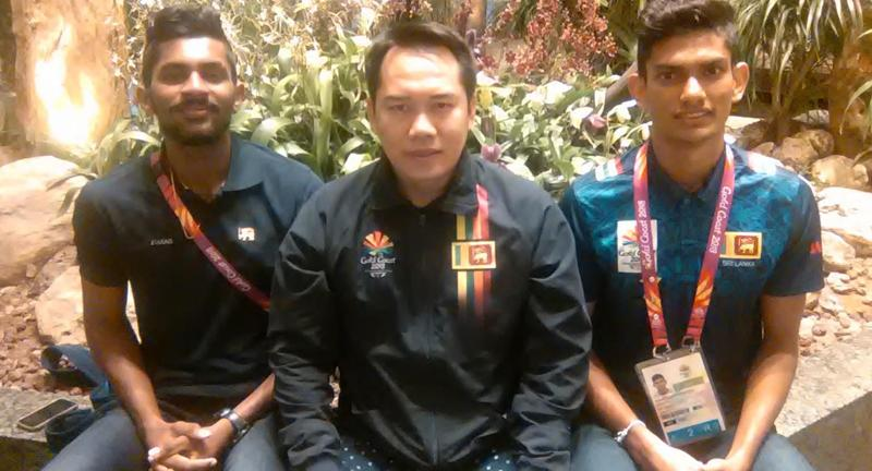 Tony Wahyudi with two promising shuttlers Sachin Dias and Buwaneka Gunatilleka