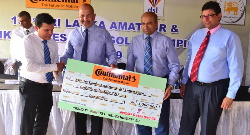 Air Chief Marshal Harsha Abeywickrema receiving the sponsorship cheque from Dammika Jayaweera (left) GM Tyres.