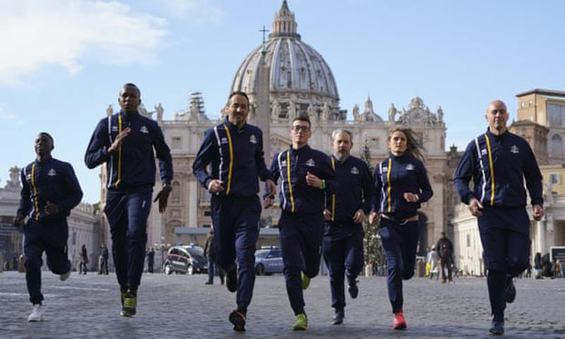 Members of the Vatican athletics team on the run