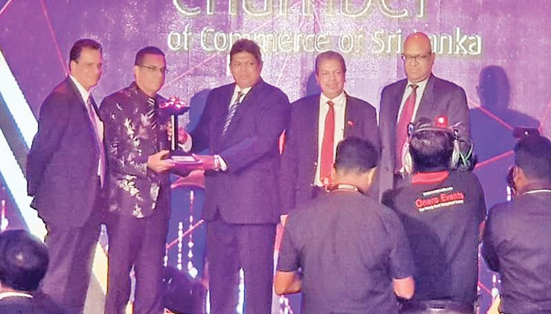 From left: South Asia Textile's Director Kenneth Wijesuriya, MD and CEO Prithiv Dorai and CFO Priyantha Hapuarachchi receive the award.