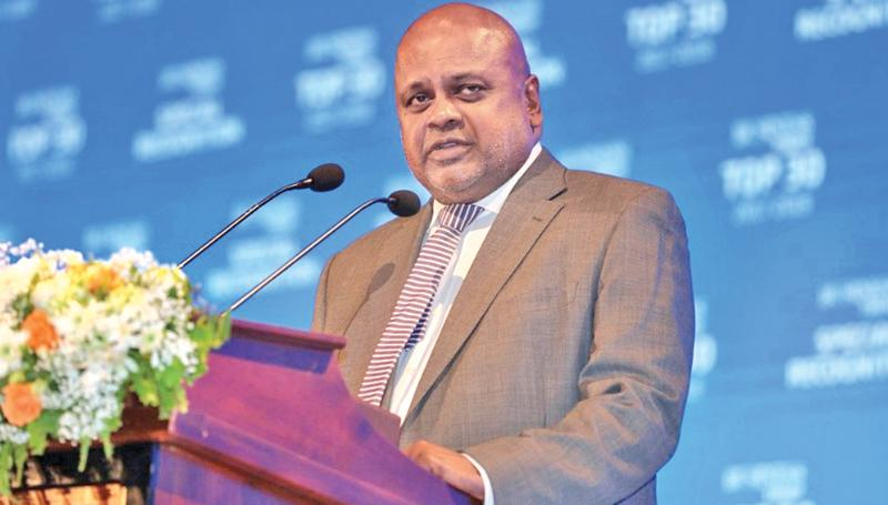Ceylinco Insurance PLC Managing Director and CEO Ajith Gunawardena speaking at the Business Today Top 30 Awards ceremony