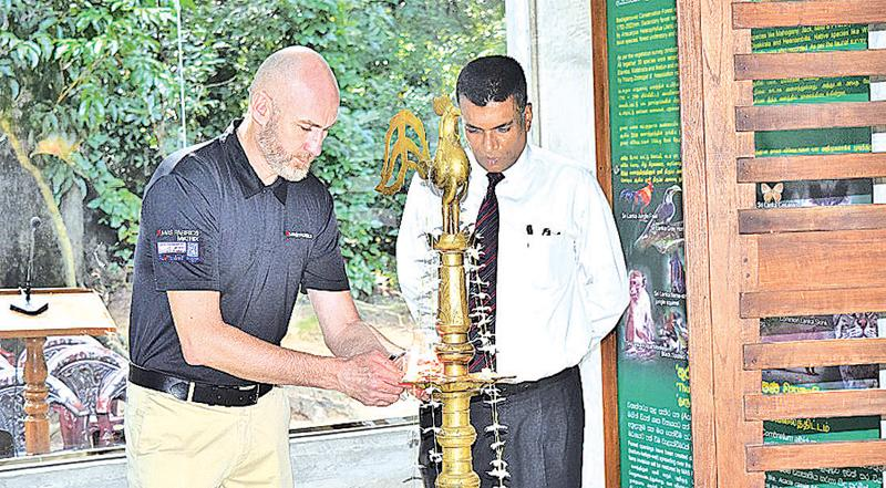 CEO of MAS Fabrics Matrix, Ivan Brown lights the oil lamp at the opening of the facility.