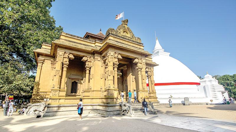 ARCHITECTURAL SHOWPIECE: The main temple building of Kelaniya and the large white dagoba