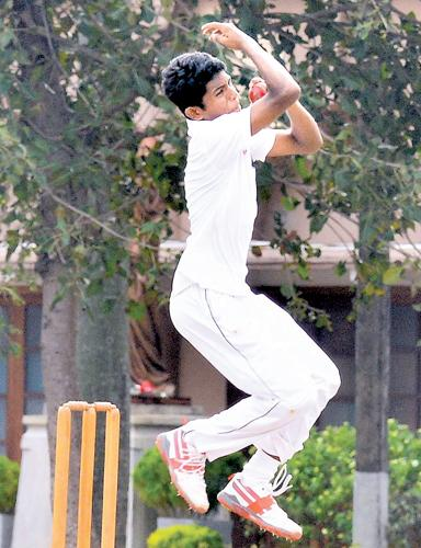 St. Joseph's College left am spinner Salinda Seneviratne bowls against Trinity College in their match at Darley Road yesterday  (Pic by Saman Mendis)