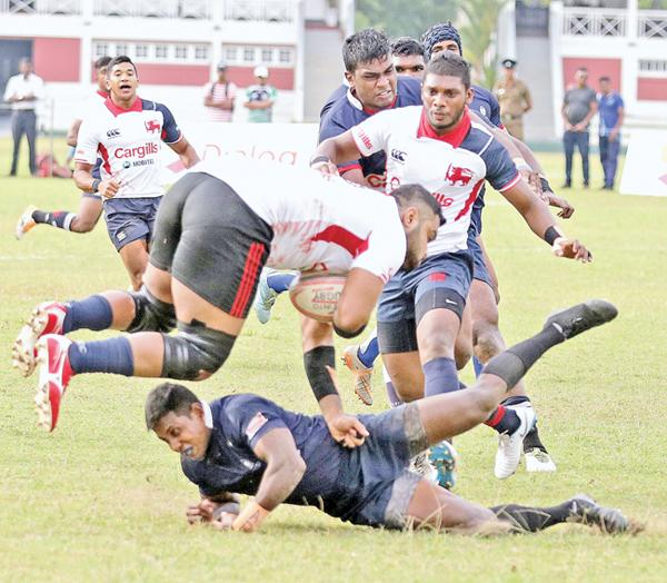 Kandy player Heshan Kalhara is sent tumbling to the ground against Police (pic by Thilak Perera)