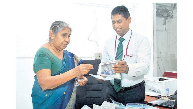 Assistant General Manager Advertising Asanga Peiris and Editor-in-Chief Dinamina, Pushpa Rowel selecting the Readers Coupon No.10 winners of Observer - Mobitel School Cricketer 2019 at Lake House Pic: Siripala  Halwala